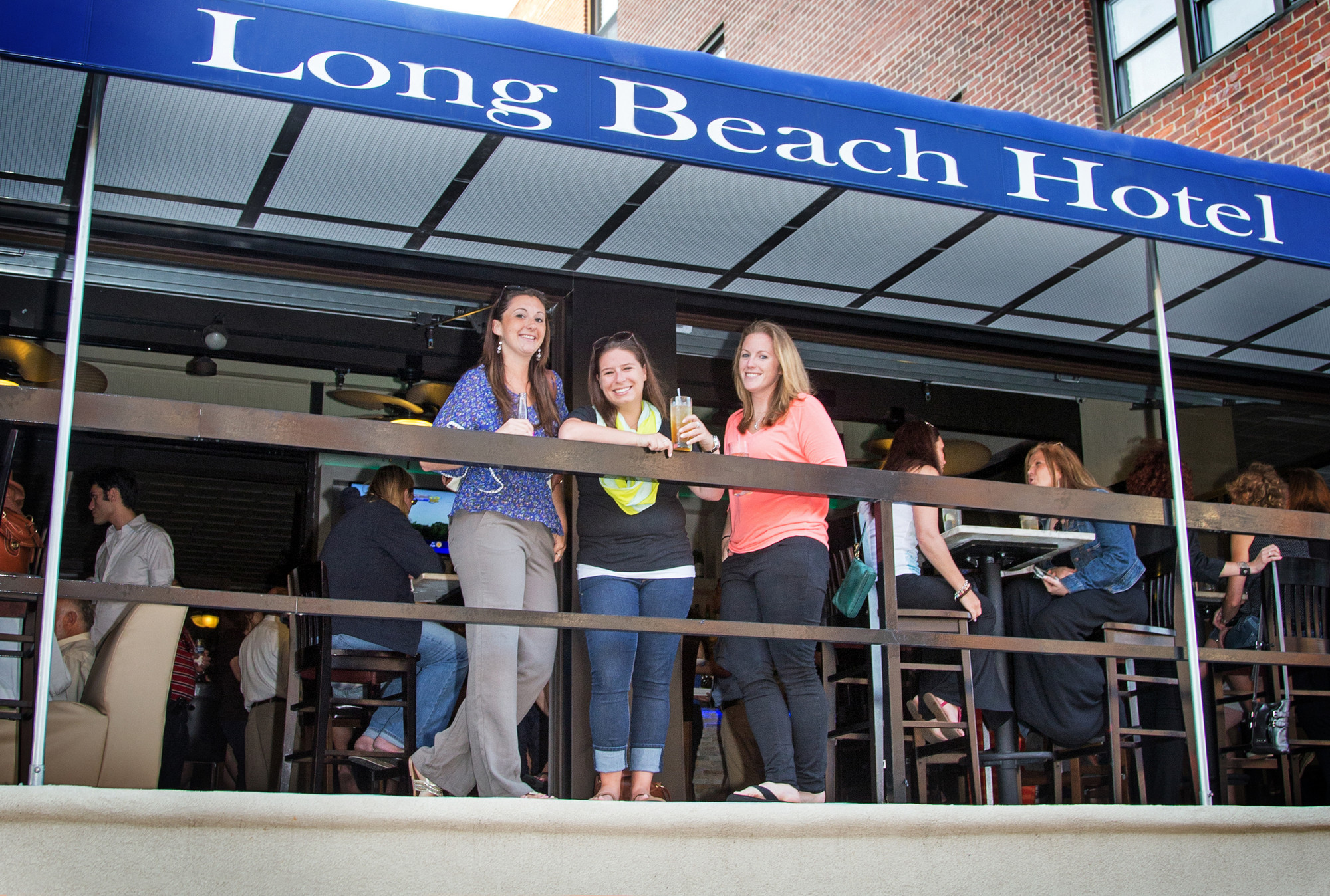 Ann Marie Morovich, left, Lauren Rapkin and Christine Morovich at the hotel's new bar.