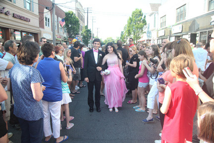 Senior Noah Chrein and junior Samantha Laskin make their way through the sea of people on Atlantic Avenue.