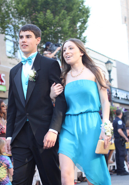 Gavin Dowd and Gaby Gerstman walk past family and friends.