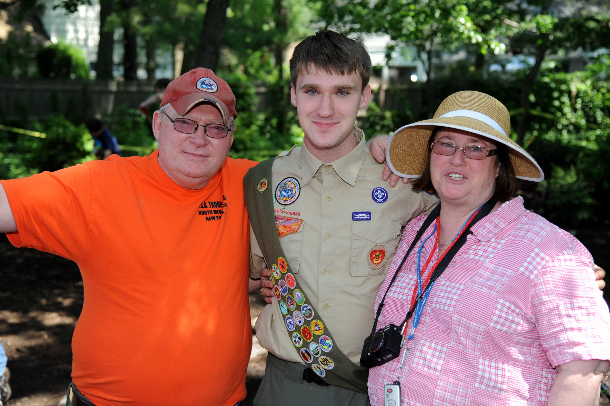 John Heverin, left, and his wife Ann, right, expressed pride in their son Sean, center, after he completed his Eagle Scout project.