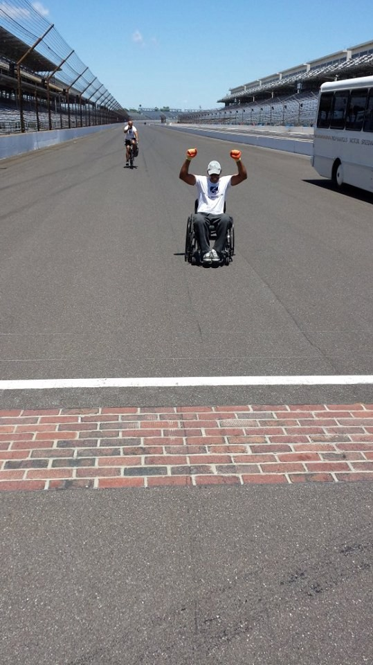 Aghabi raised his fists in triumph as he crossed the finish line at the Indianapolis Speedway a few weeks before crossing his own personal finish line.