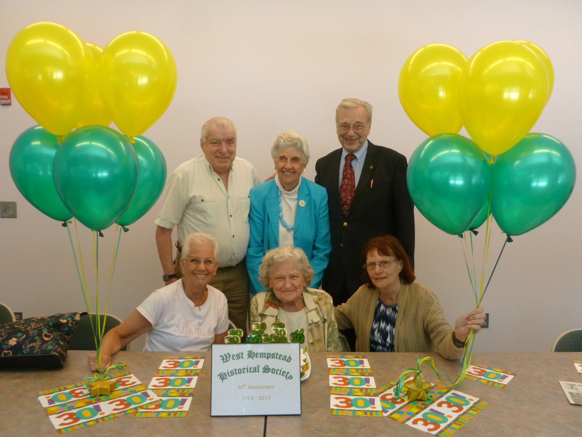 West Hempstead Historical Society members Bill Rilling, back left, Helen Duryea, President John Shaud, and Linda Brohm, front left, Justine Niedz and Joan Klopfer celebrate 31 years of educating residents about their town's rich history.