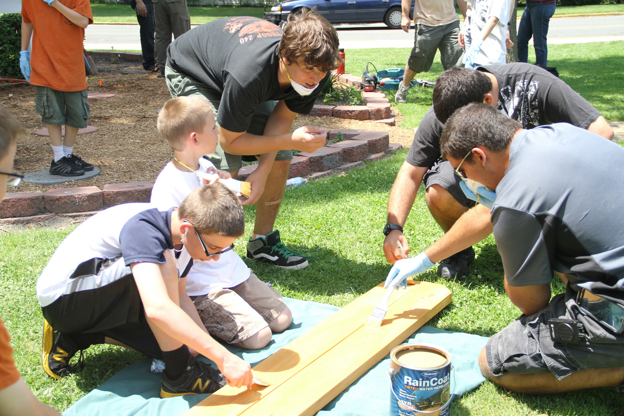 Future Eagle Scout Antonio Verderosa supervises the work being done on the picnic table.