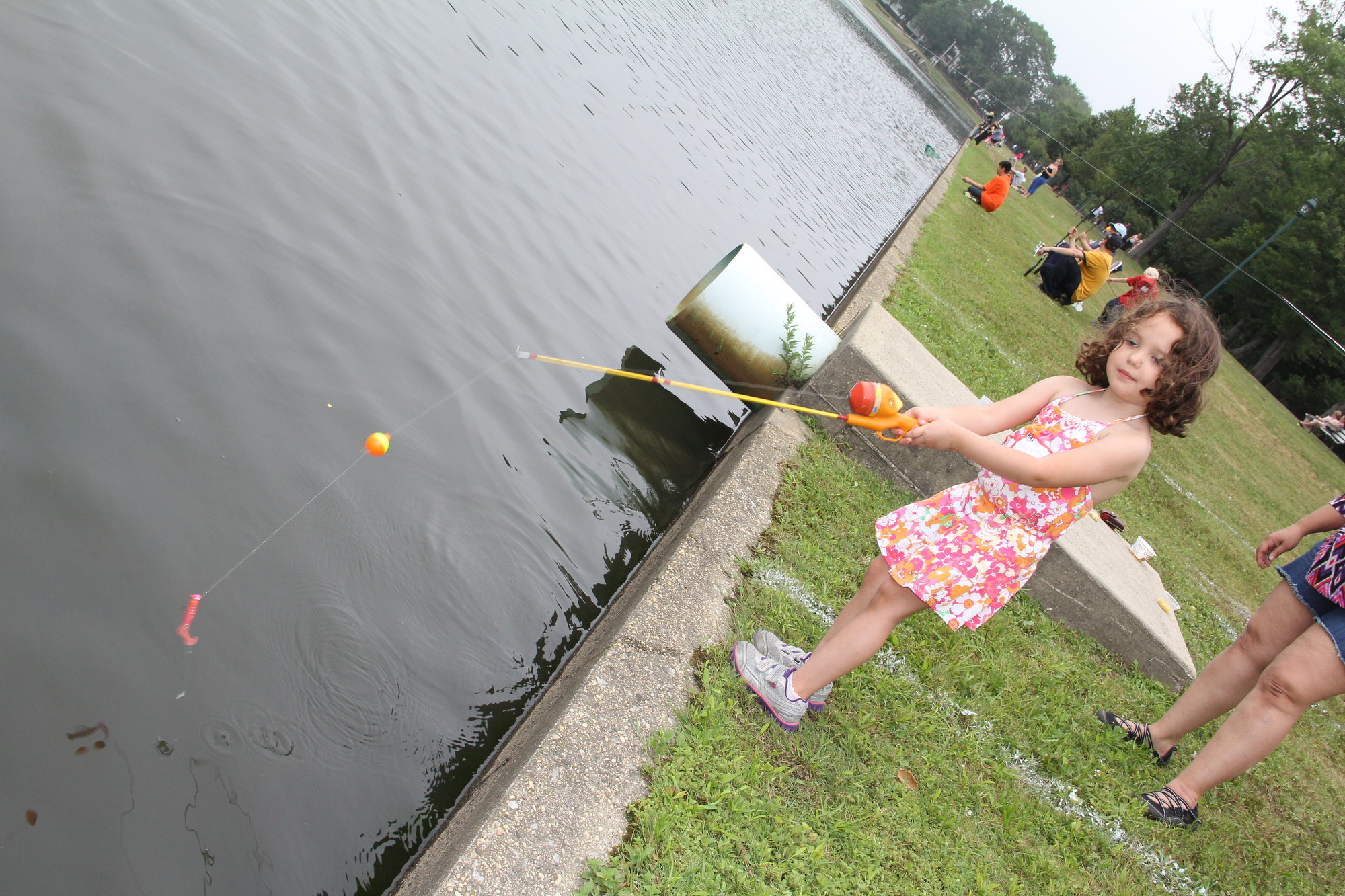 Charlotte Prial, 4, has a great time on her first fishing trip at Hendrickson Park last Sunday afternoon.