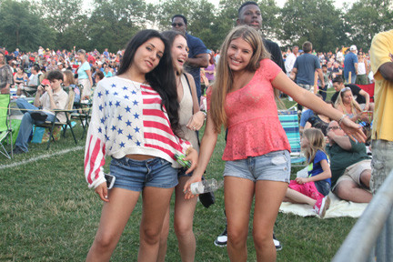 Ariel Purnsrian, at left, with Daria Hasson and Lindsay Weinberg, showed their patriotism with a cheerful dance.