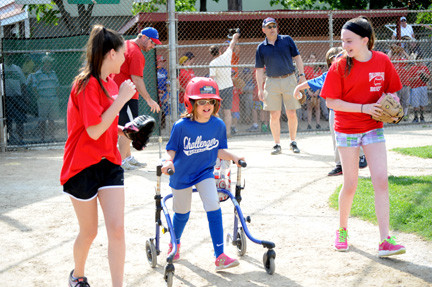 Julia Modico, 10, ran to first base with her buddies Abby Bruno, left, and Nicole Cummins.