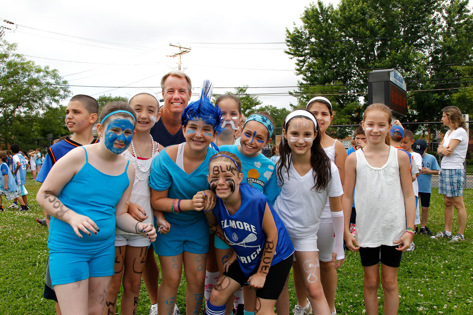 Physical Education teacher John Wolkiewicz enjoyed a moment with members of Ms. Cammarata�s fourth grade class before the events began at Winthrop Avenue.
