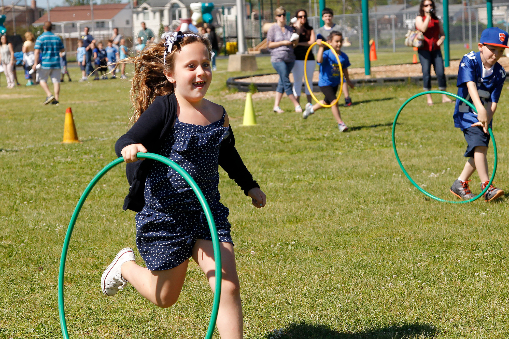 First-grader Olivia Randazzo held on to her hula-hoop while competing in a relay race.