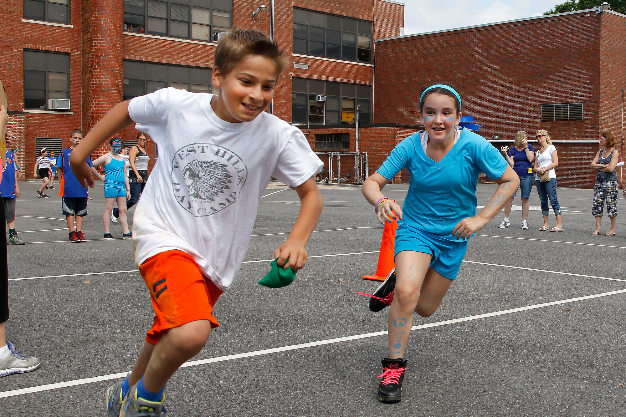Fourth-grader Jared Raso tried to outrun Samantha Bergman while playing capture the flag.