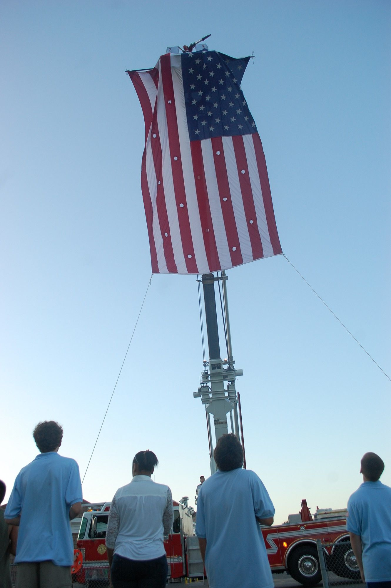 The Junior Fire Department helped raise the flag for the playing of the National Anthem.