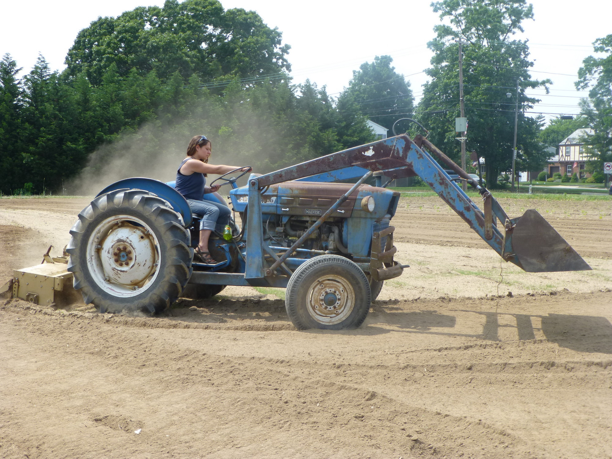 Crossroads Manager Elizabeth Schaefer tilled the fields on her tractor.