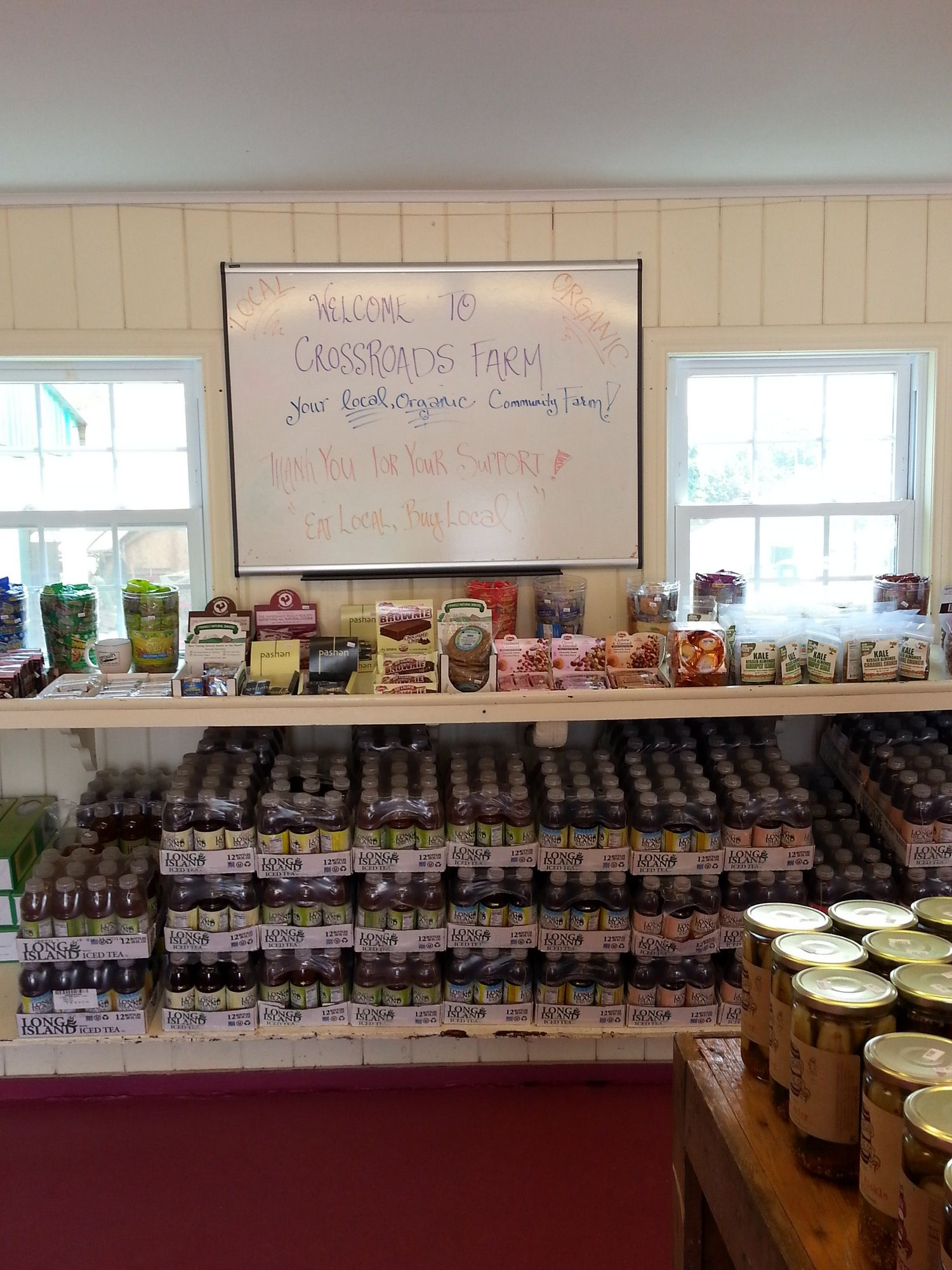 The farm stand at Crossroads offered a variety of organic health foods and baked goods, including organic nuts, dried fruits, trail mixes, brownies, cakes and cookies, fruit spreads and jars of honey from its resident beehive.