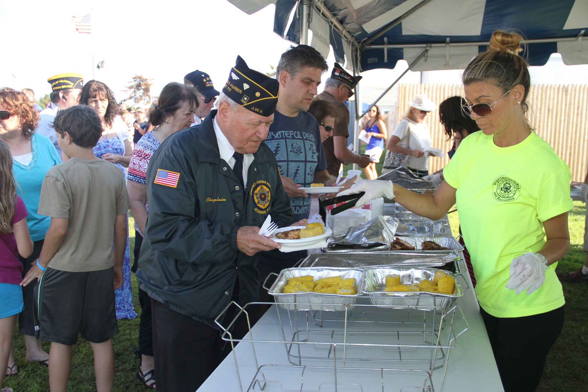 Chaplain Leonard Levine of Post 717 Oceanside, hits the buffet line.