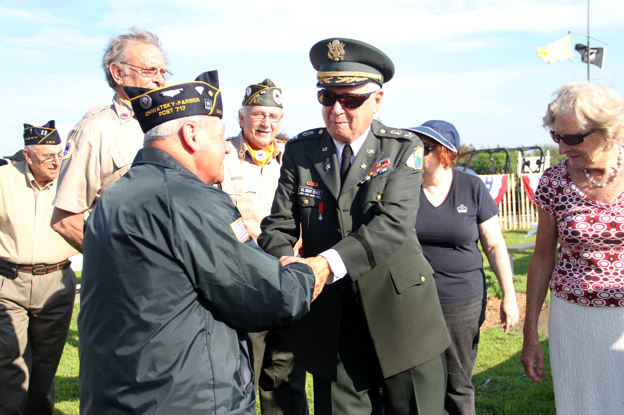 Robert Schatz of Oceanside is congratulated by Oceanside Chaplain Leonard Levine.