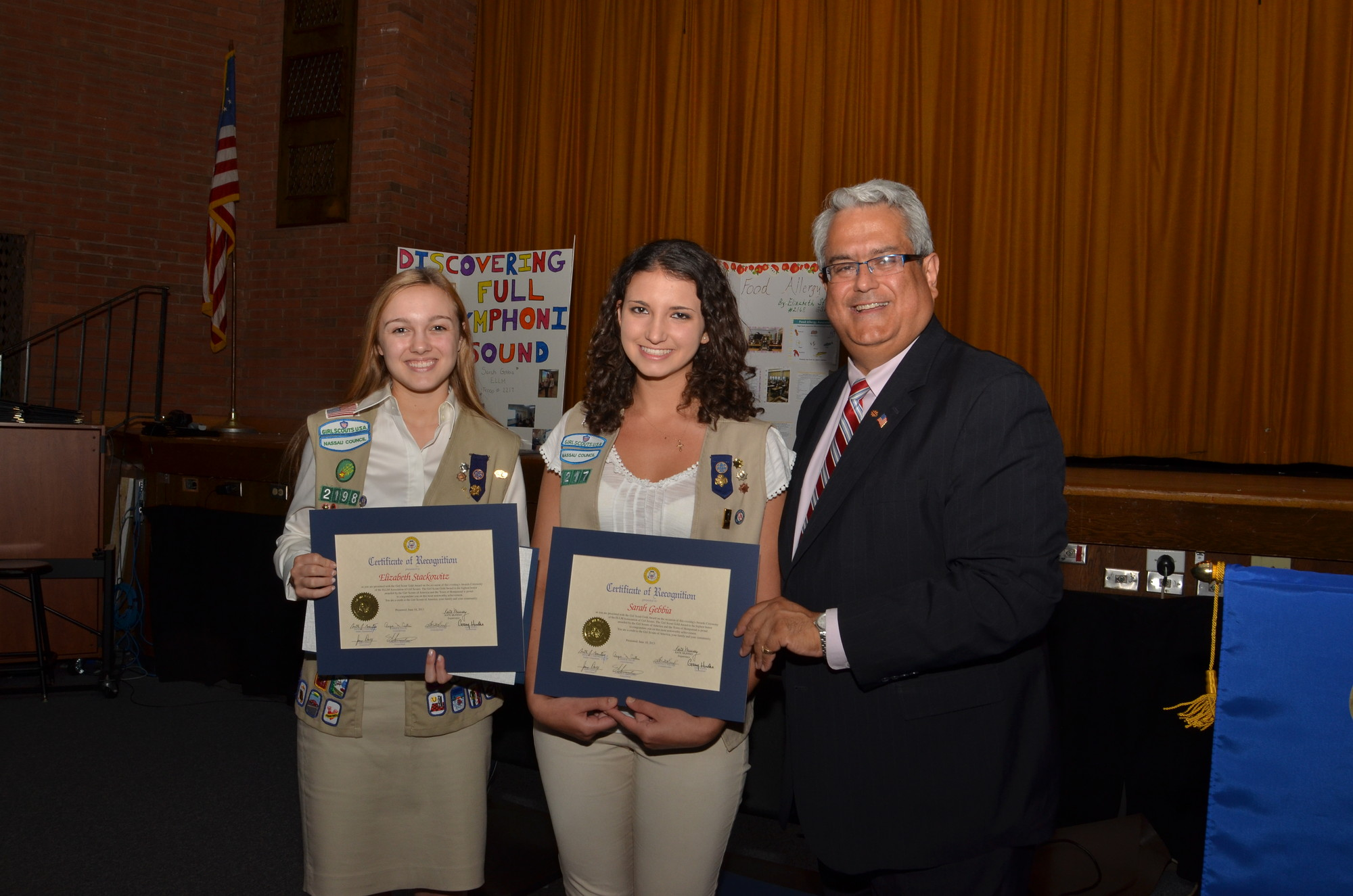 Councilman Santino congratulated Elizabeth Stackowitz, left, and Sarah Gebbia for their tireless service as Girl Scouts and presented them with the Gold Award.