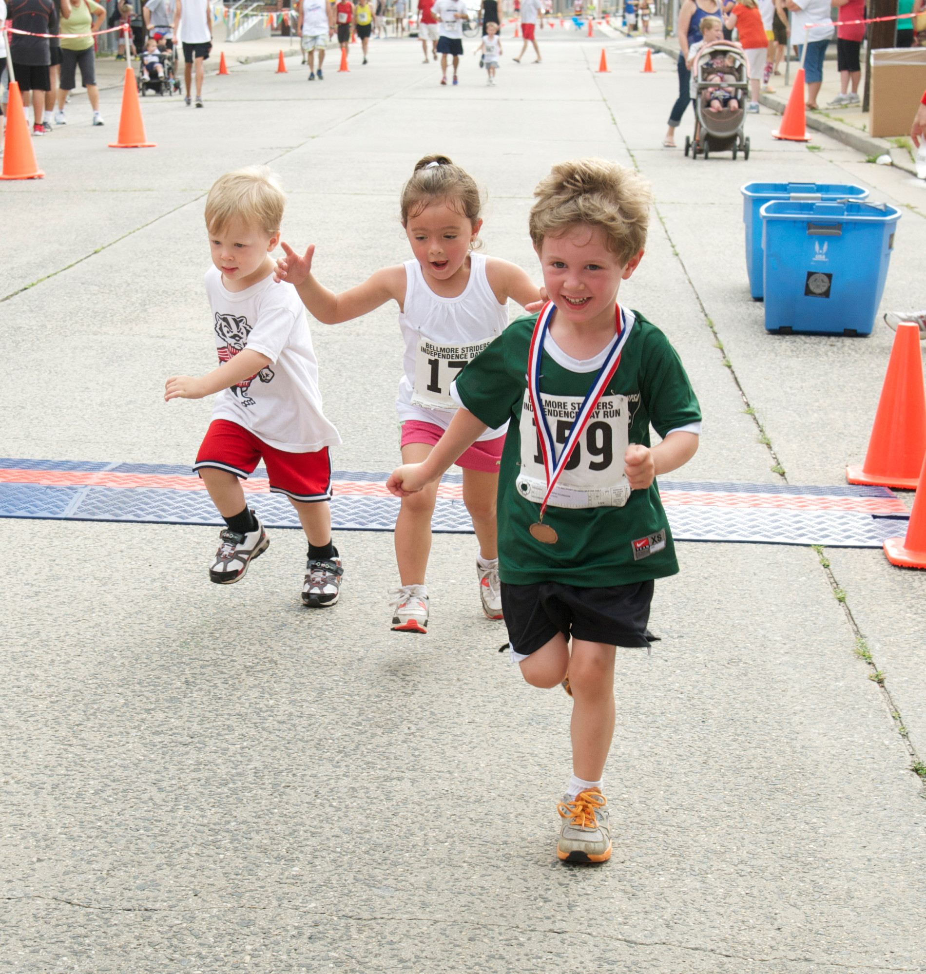 Kevin Ellington, 2, Madelyn Forquignon, 4, and Timmy Ellington. 4, crossed the finish line in 14 minutes and 10 seconds in the Bellmore Striders' one-mile run.