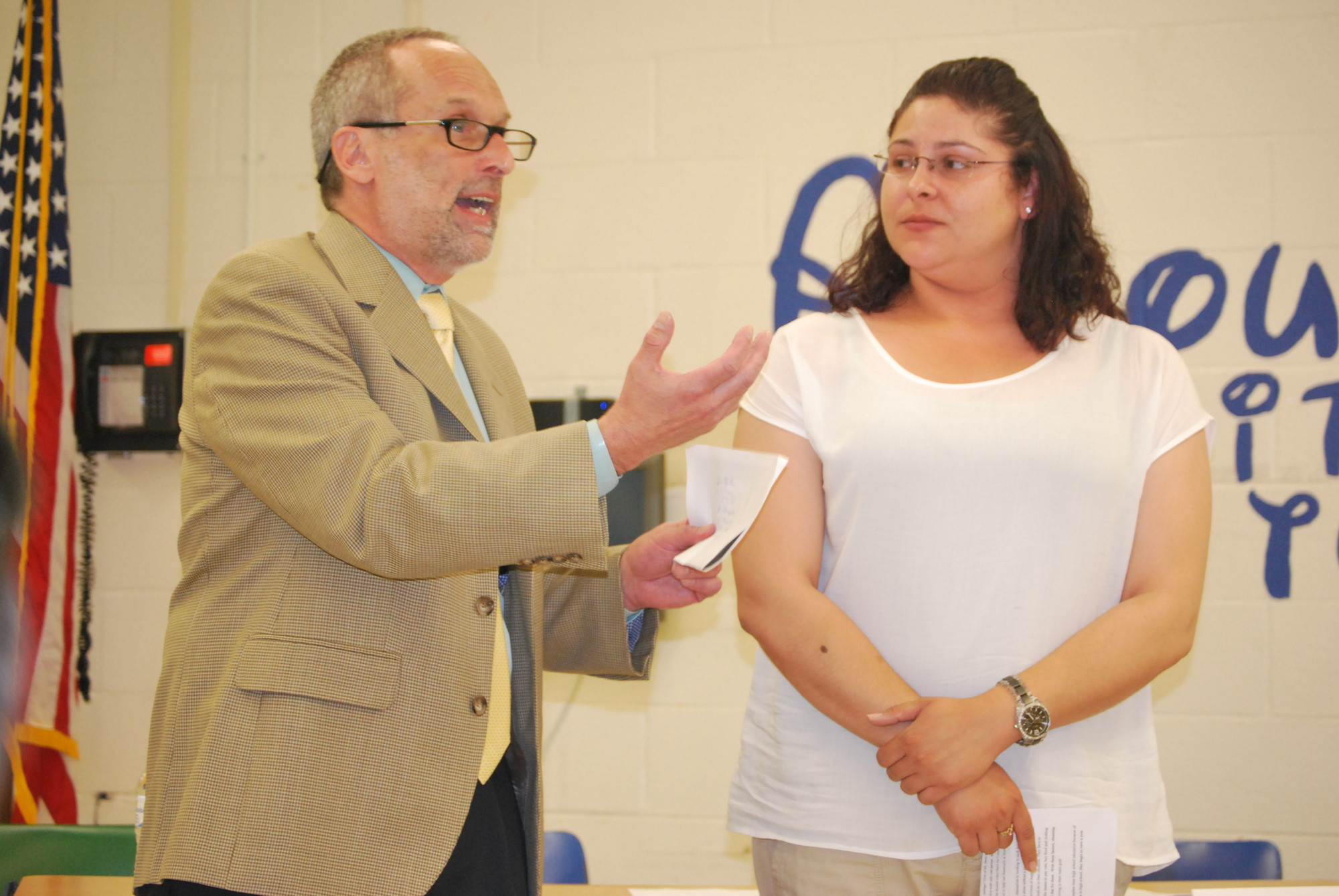 The Lawrence School District unveiled plans to improve student academic achievement. Above, Superintendent Gary Schall and guidance counselor Veronica Ortiz explained the issues involved at a 