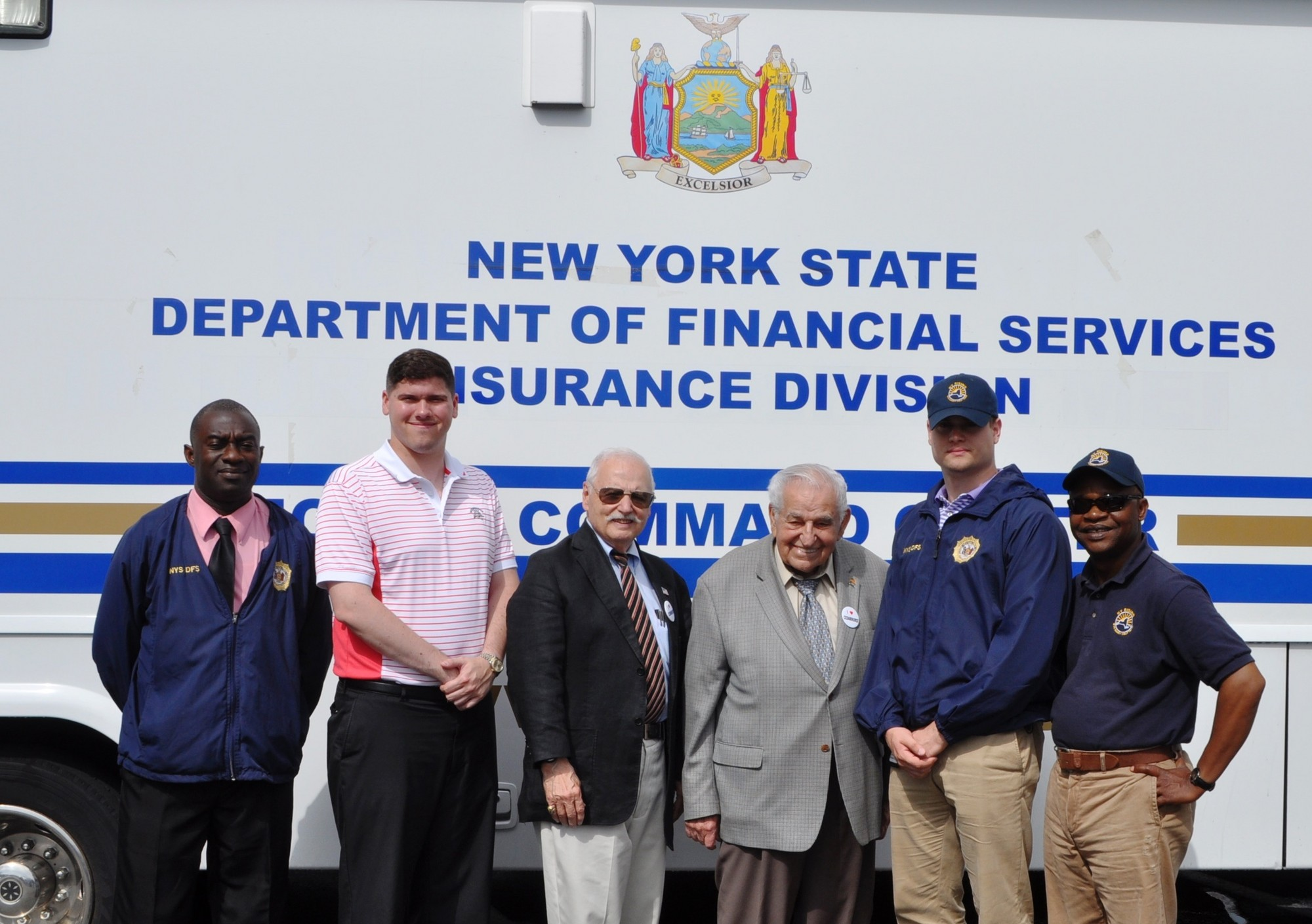 Hurricane Sandy victims received assistance from the state's Department of Financial Services outside of Cedarhurst Village Hall. Clivell R. Wilson, Michael Romano, Trustee Ron Lanzilotta, Mayor Andrew J. Parise, Mathew Meyer and Cyprian M. Osutl.