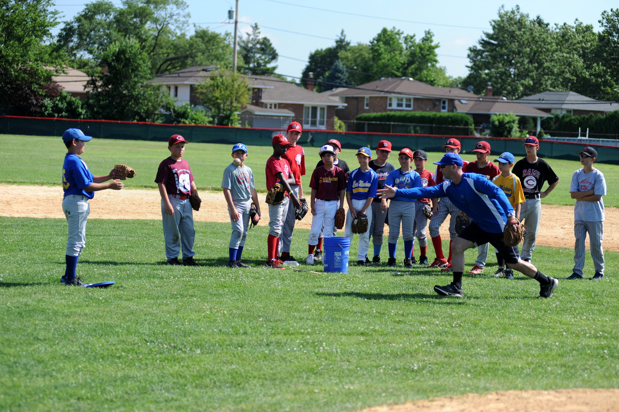 Will Palmer, a guidance counselor in the East Meadow School District and a coach of Clarke�s junior varsity team, showed kids the fundamentals during the Creative Arts Program of East Meadow�s summer baseball camp.