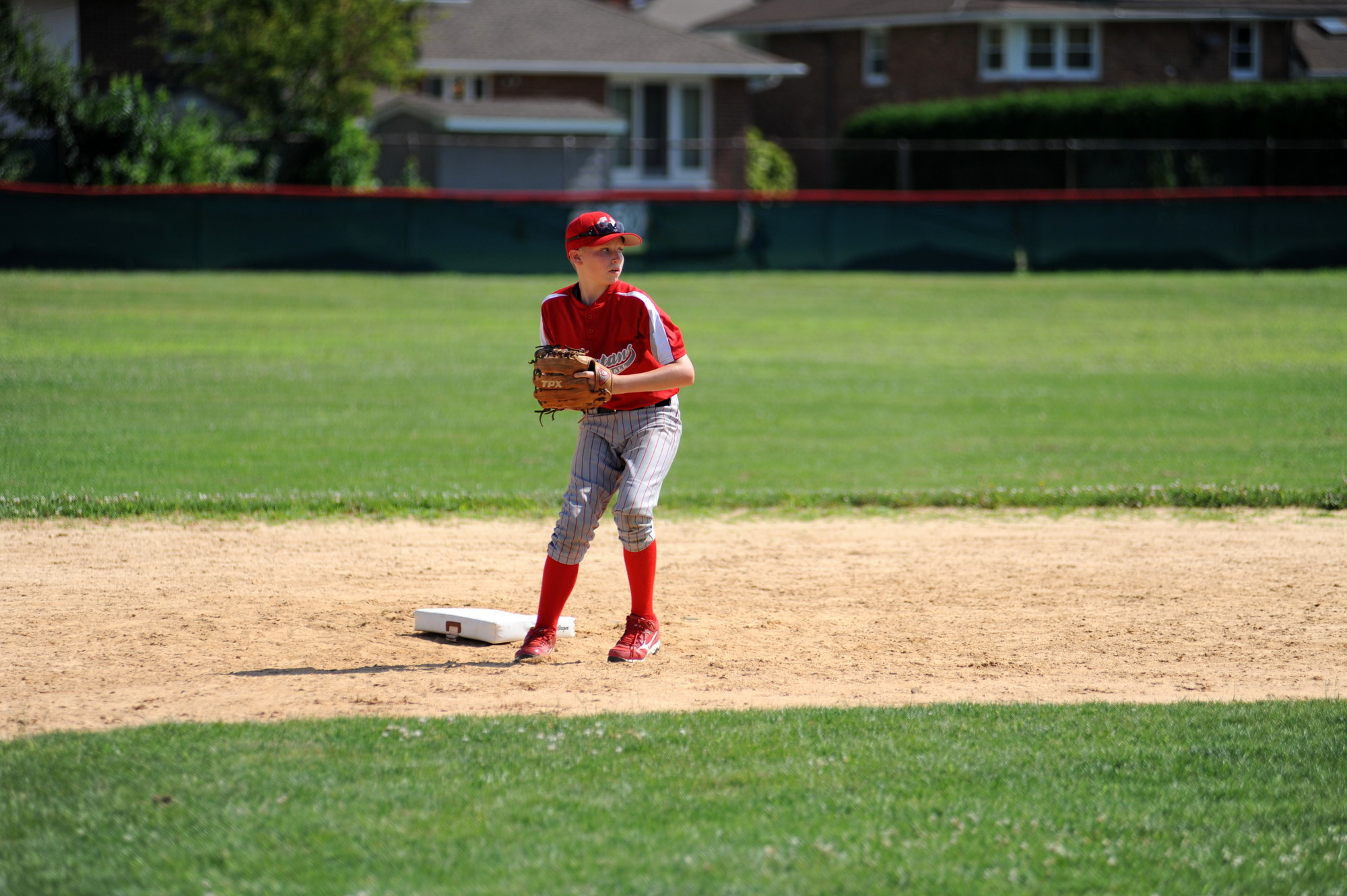 Brendan Turton fired a ball from shortstop during the baseball camp.