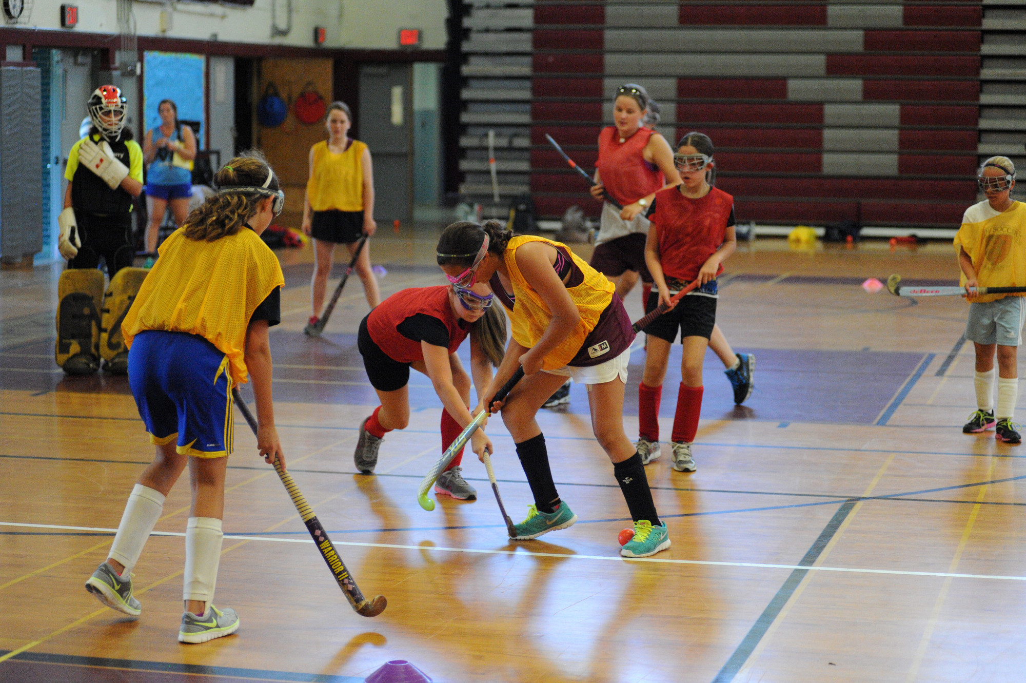 Faith Coughlin and Gabriella Sferrazza battled for a loose ball in a game of field hockey, which has been played at Clarke High School since 1959.