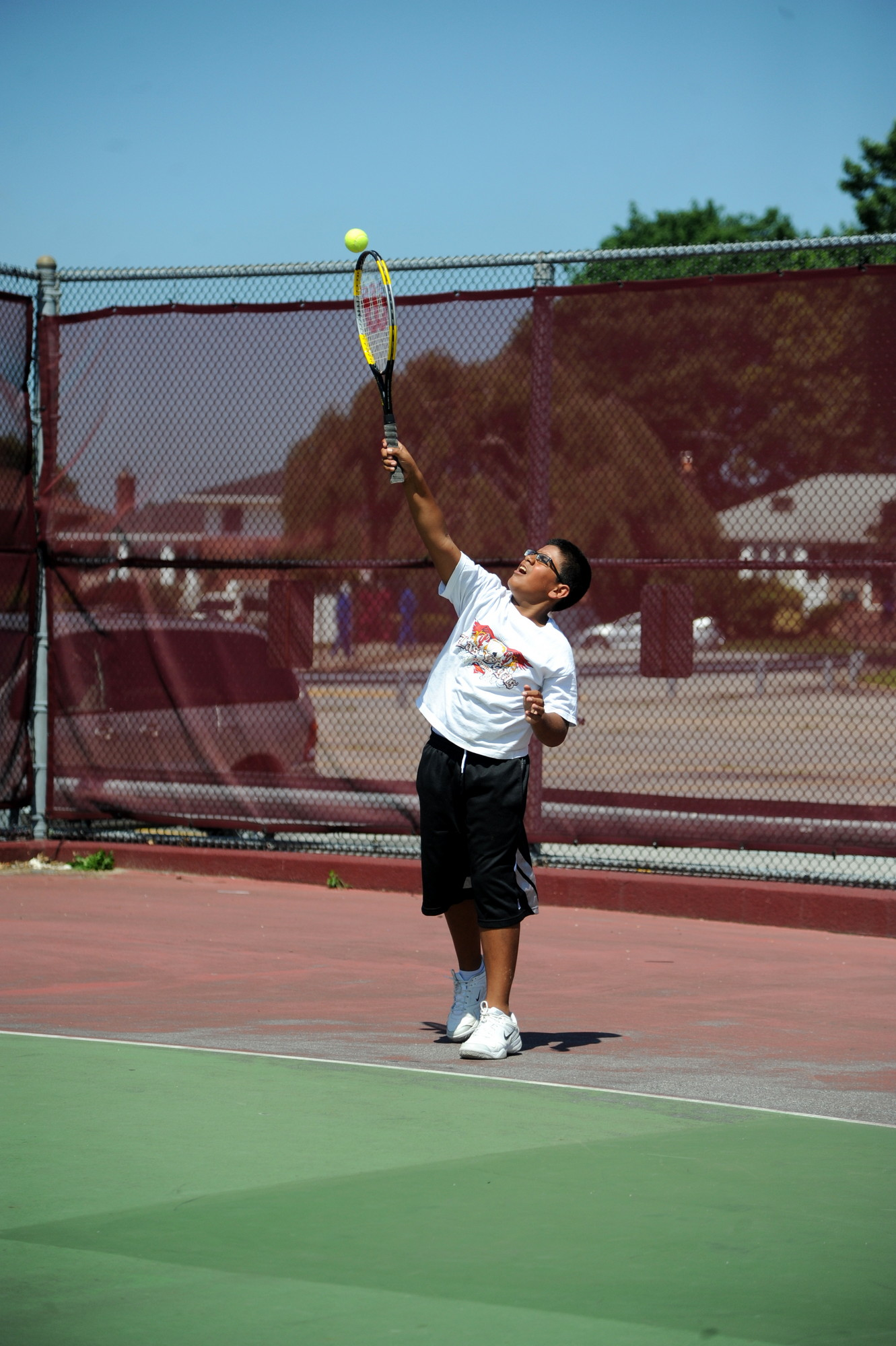 Ashique Hasany served during the tennis portion of East Meadow�s CAPE Summer Sports Program.
