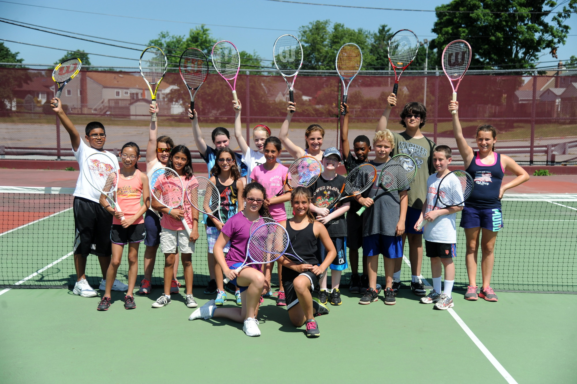 Rackets up! The East Meadow School District�s CAPE summer camps offer instruction in a variety of sports, including tennis.