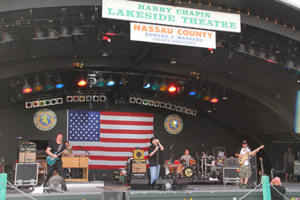 Blues Traveler entertained Eisenhower Park�s crowded Harry Chapin Lakeside Theatre with rock and blues hits on June 22 during Nassau�s summer concert series.