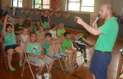 Matt Roth, director of Grace Methodist Church's vacation Bible school, greeted students on June 27, the last day of camp.