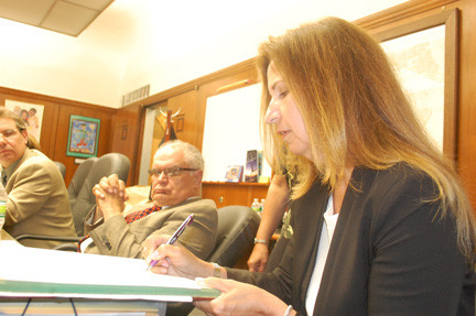New District 13 Trustee Toni Pomerantz signed the oath of office on July 8.