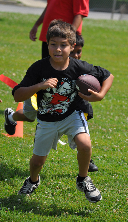 Michael Hernandez, 7, has been learning basic football skills.