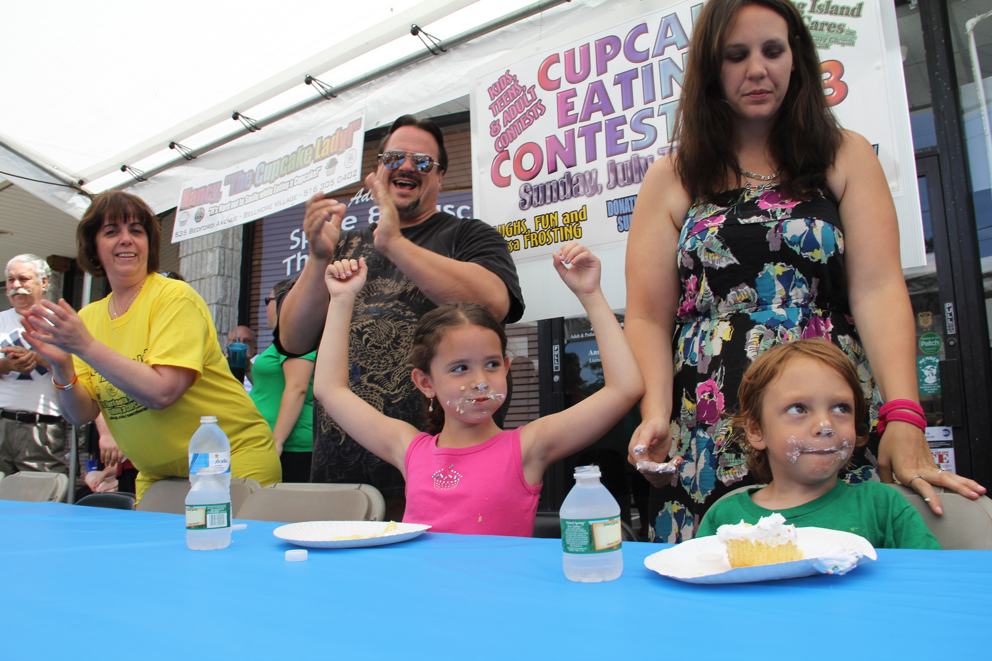 Nancy Moniodes, left, cheered on Danielle Manganiello, 6,  with her father, Mark, after she tied for first in the contest.