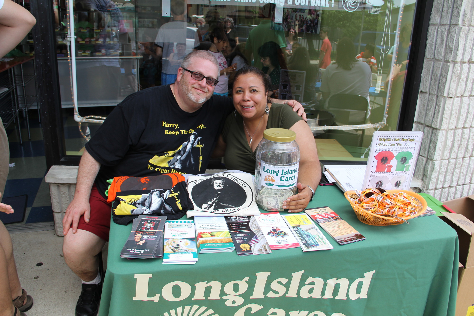 Scott Passik and Marinnette Flores, from left, accepted donations for Long Island Cares.