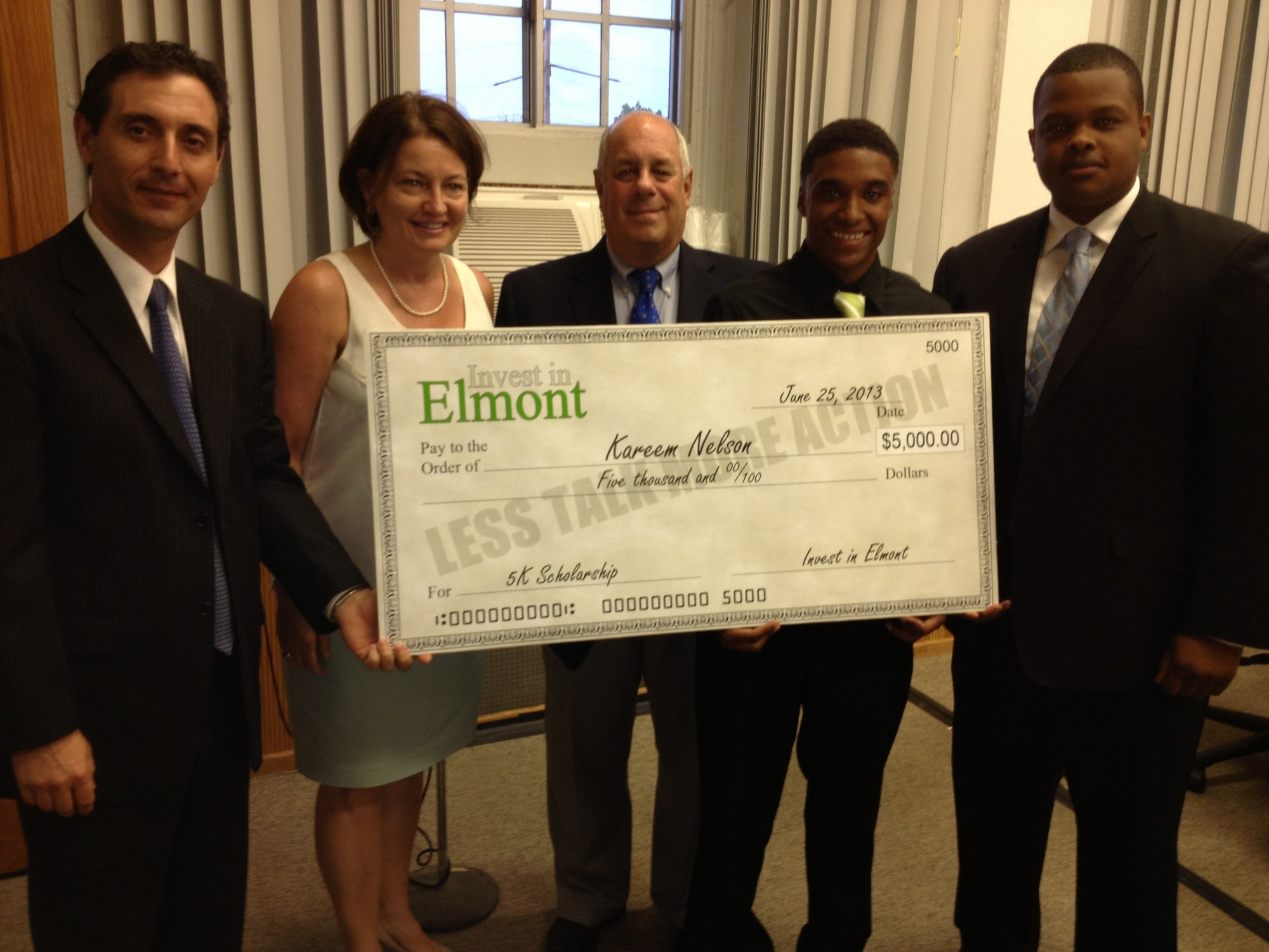 Invest in Elmont co-founder Muzzio Tallini, far left, Floral Park Memorial High School Principal Kathleen Sottile, Sewanhaka Schools Superintendent Dr. Ralph Ferrie, contest winner Kareem Nelson and Invest in Elmont co-founder Carl Achille after Nelson�s business idea for Belmont Park was announced as the program�s winner.