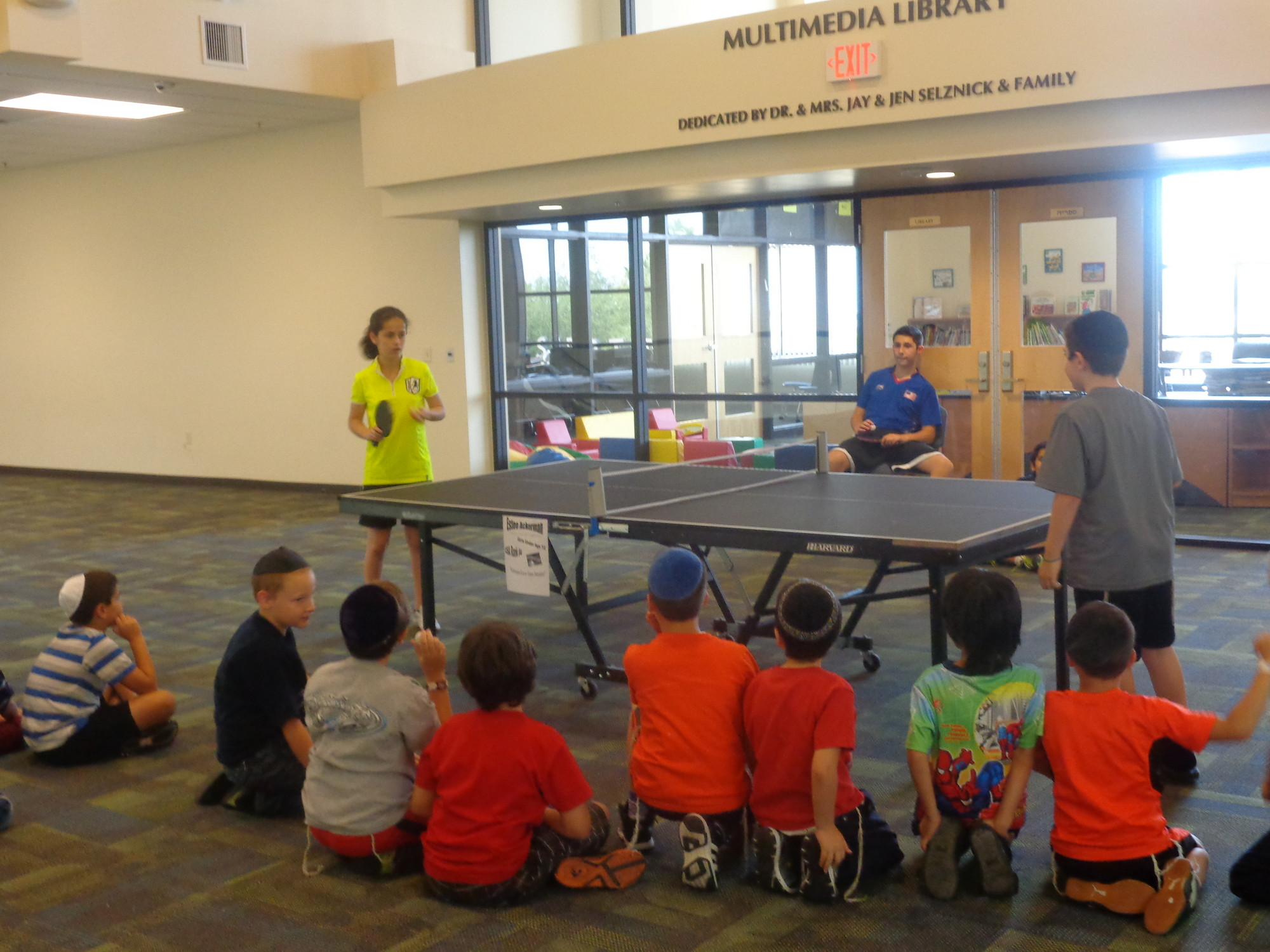 Estee Ackerman played with some of the campers in a table tennis demonstration.
