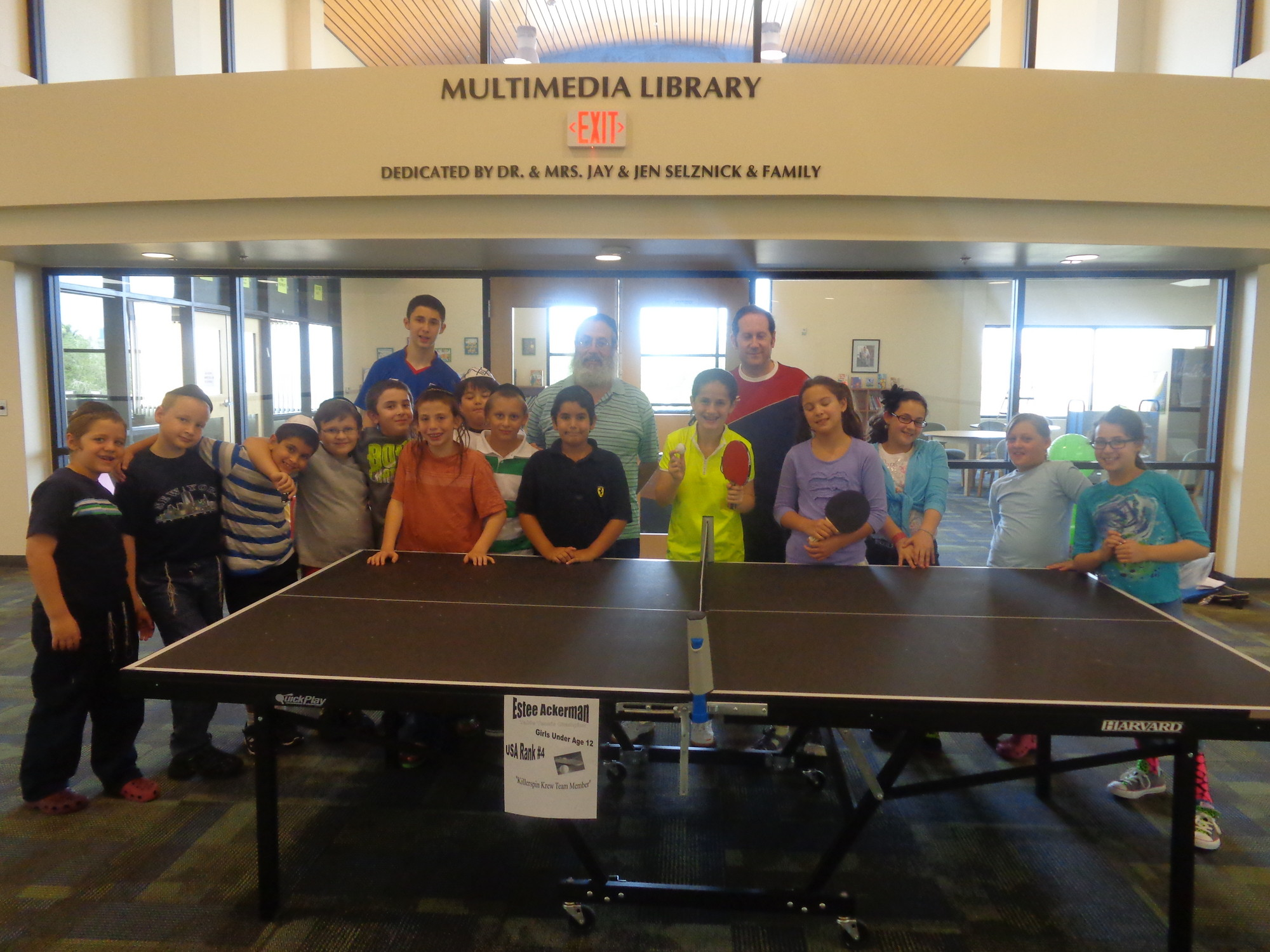 Akiva, back left, and Estee Ackerman, center, schooled young campers at the Desert Torah Academy Day Camp in Las Vegas on table tennis.