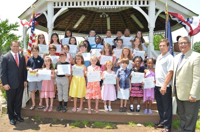 Councilman Anthony Santino honored Assemblyman Brian Curran's Flag Day Art/Essay Contest winners at Gress Park in Lynbrook. A winner and an honorable mention from Baldwin, Malverne, Lynbrook, and East Rockaway school districts were presented with a Citation.