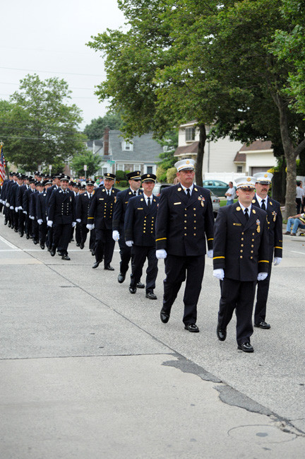 Chief Christopher O'Brien led the Bellmore Fire Department, which hosted this year's county parade, through local streets on Saturday evening.