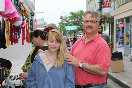 Todd Litz helped his daughter Madassin put on the new necklace he just bought for her.