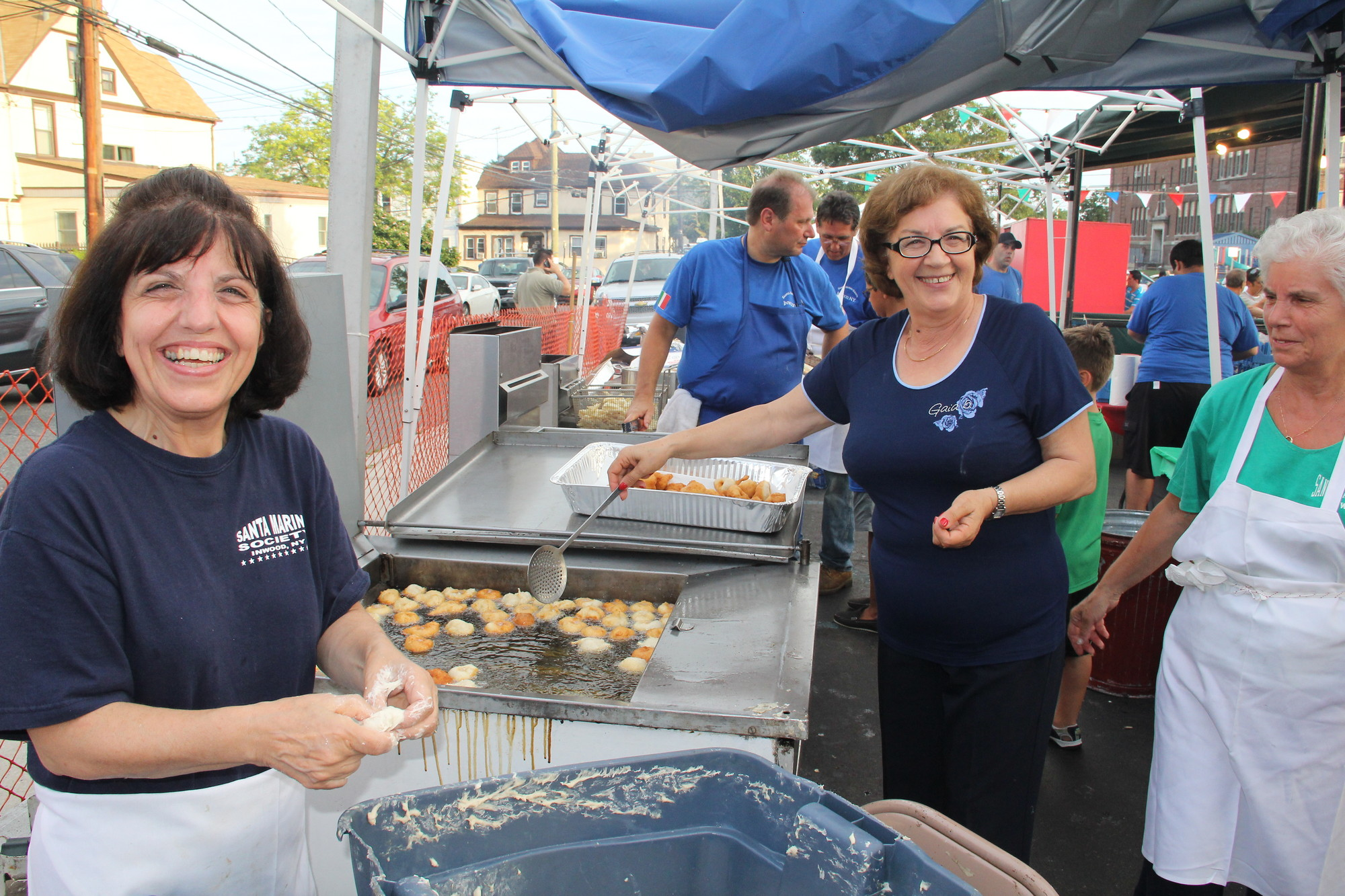 Food was one of the top attractions at the feast. From left, Pasqualina Curra, Lina Curra and Lina Pugliesi helped to make the zeppoles.