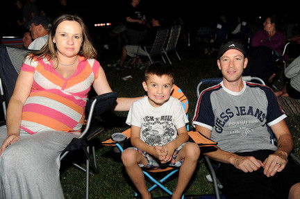 Maggie Zenie, left, sat back to take in the night�s sights and sounds with Liam, 5, and Michael.