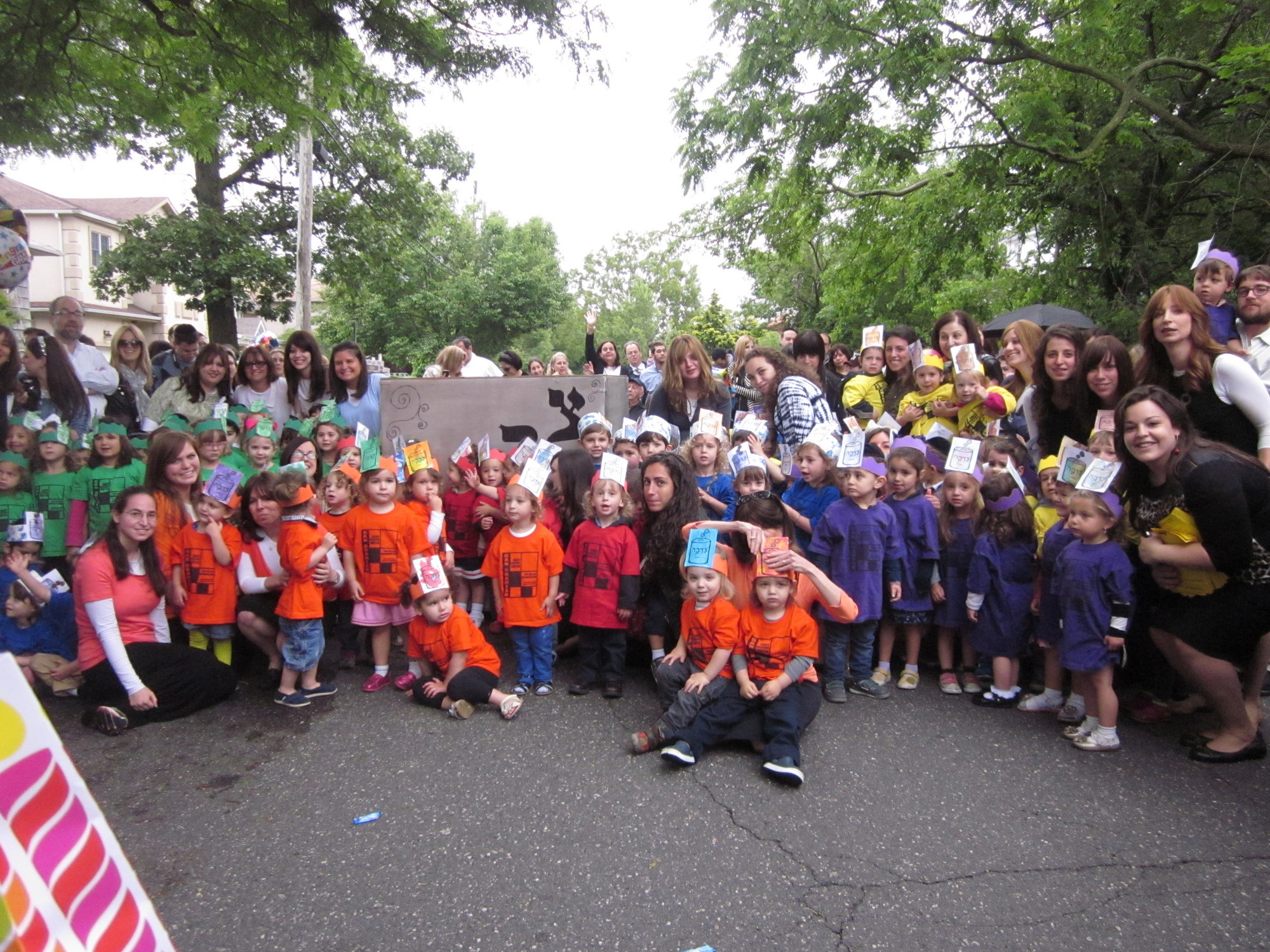Chabad preschool students celebrated their graduation with a march in Maple Avenue and donating to Hatzalah.