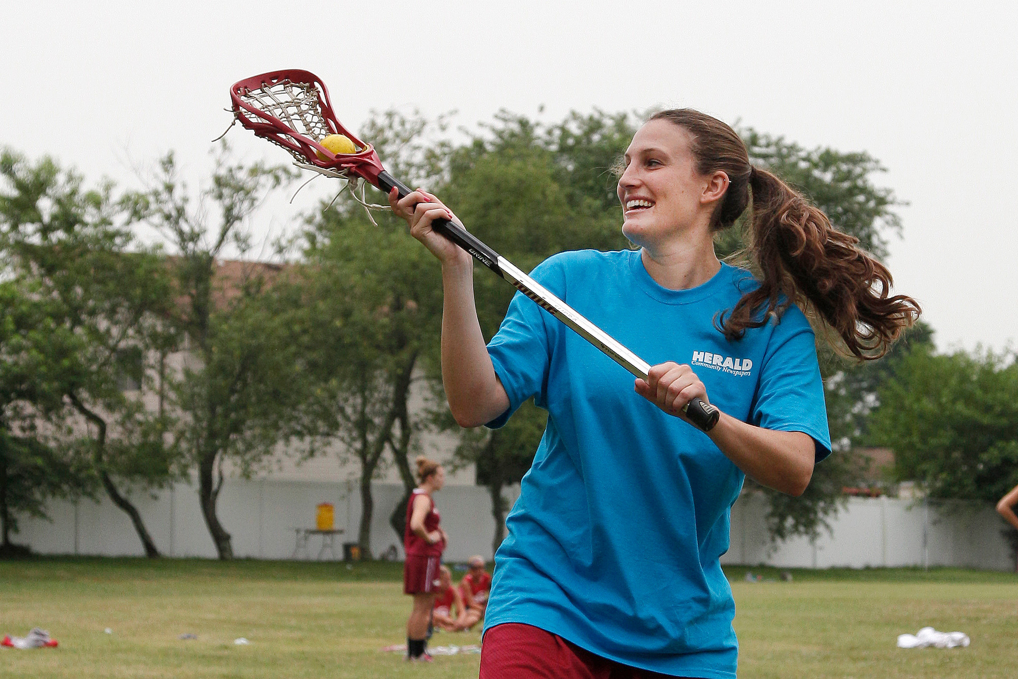 Jess Rosen, a Lynbrook High School graduate, tried her hand at lacrosse for the first time during the Town of Hempstead's summer clinic.