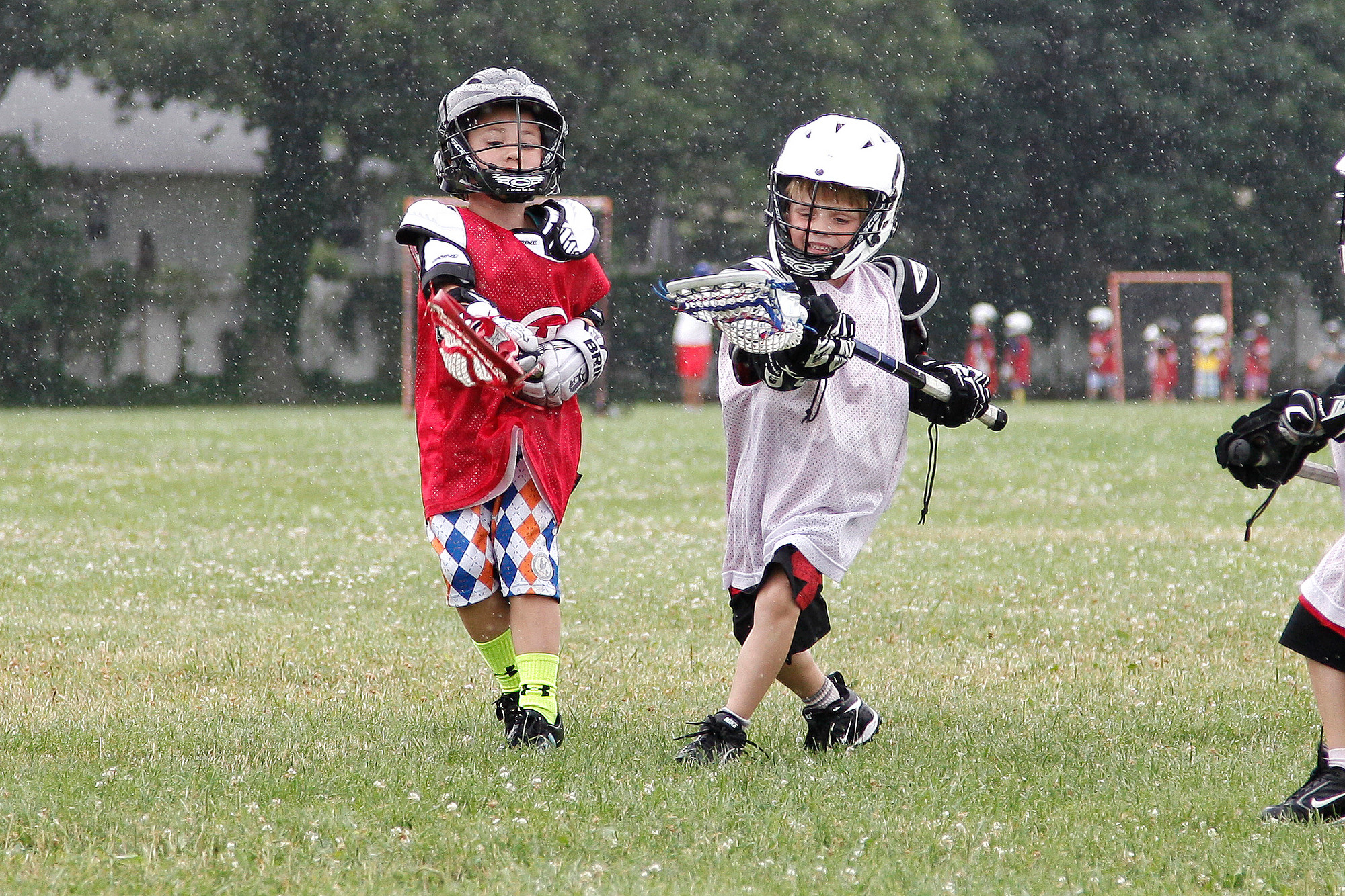 Ryan Zsamboky, left, and Owen Stalhilik honed their skills in the rain at the Town of Hempstead Lacrosse Academy in East Meadow's Speno Park on July 11. The boys were in the 5- and 6-year-old age group, the youngest the clinic offers.