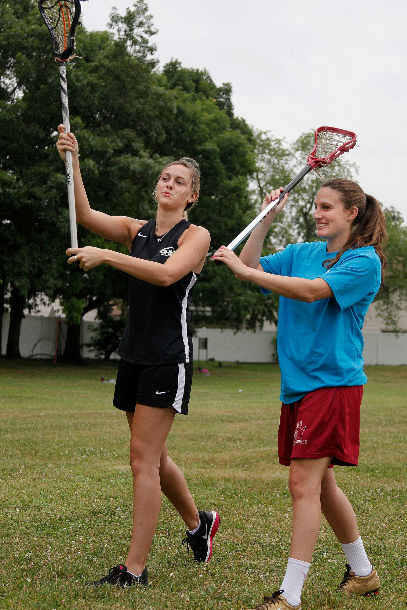 Jaclyn Quinn, left, a Quinnipiac student who played lacrosse at Wantagh High School, taught Herald intern Jess Rosen proper stick handling.