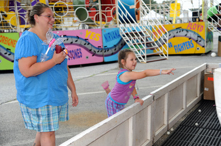 Bella Mallon looked on while Melony, 3, tried to win a gold fish at a carnival sponsored last weekend by the Bellmore Fire Department.