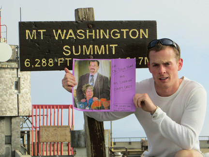 Jason Lynch honored three families who are affected by Alzheimer�s disease. Here he is hold up a photo of the Humes after one of his three climbs.