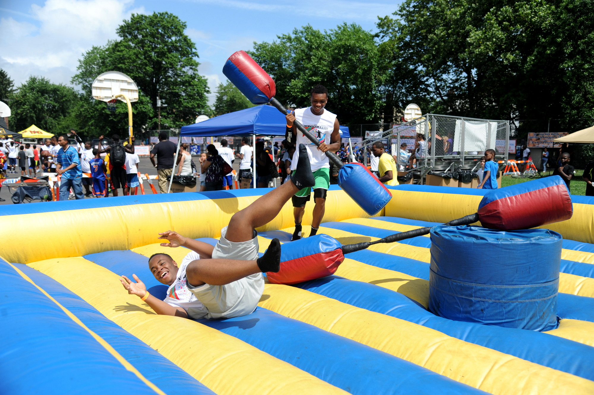 Elmont Memorial High graduates Sean Charles, left, and Anthony James had a blast jousting at Sen. Jack Martins's Sports Classic Tournament in Elmont on Saturday.