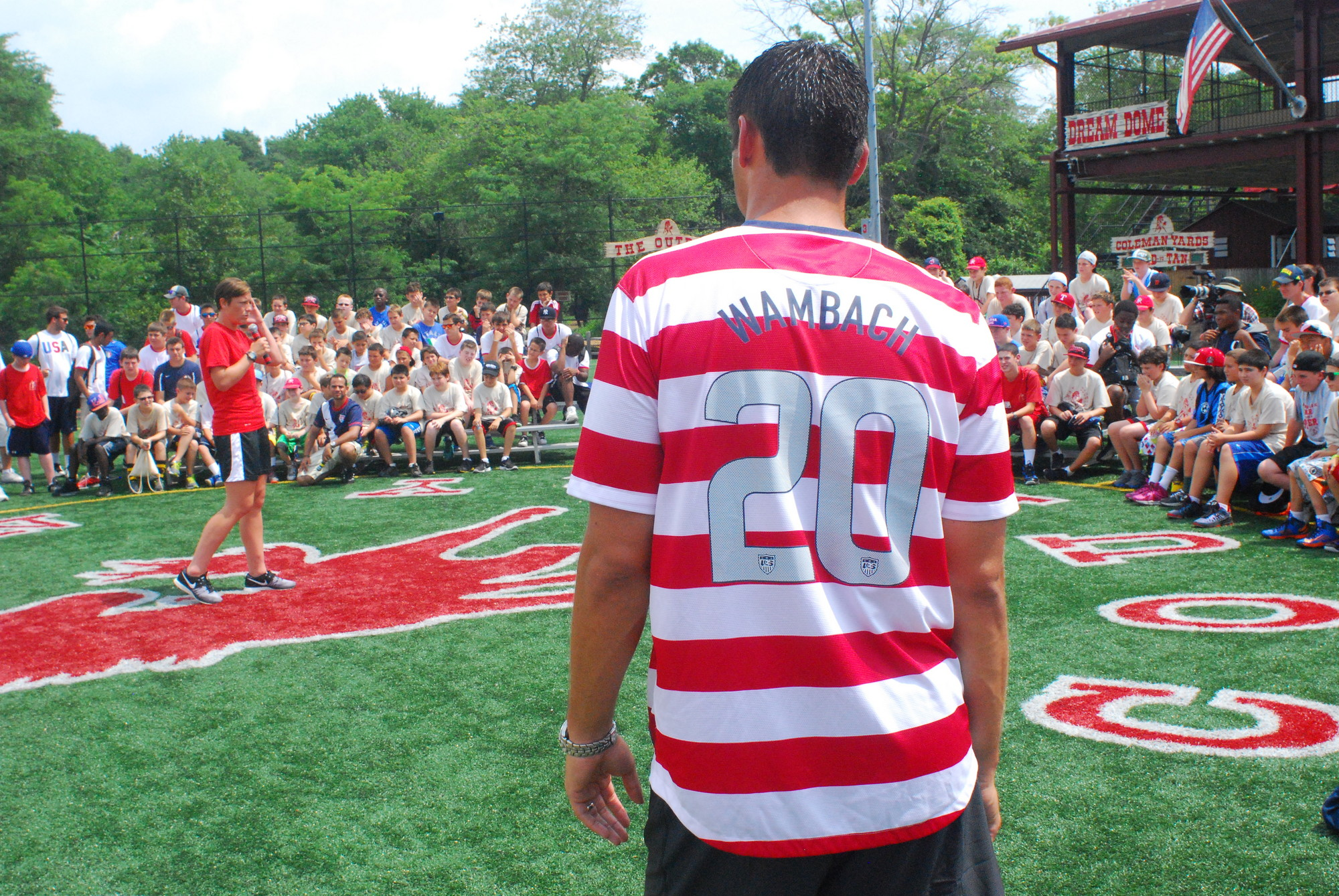 Coleman Country Camp Director Ross Coleman, front, wore a Wambach replica jersey to celebrate the soccer phenom.