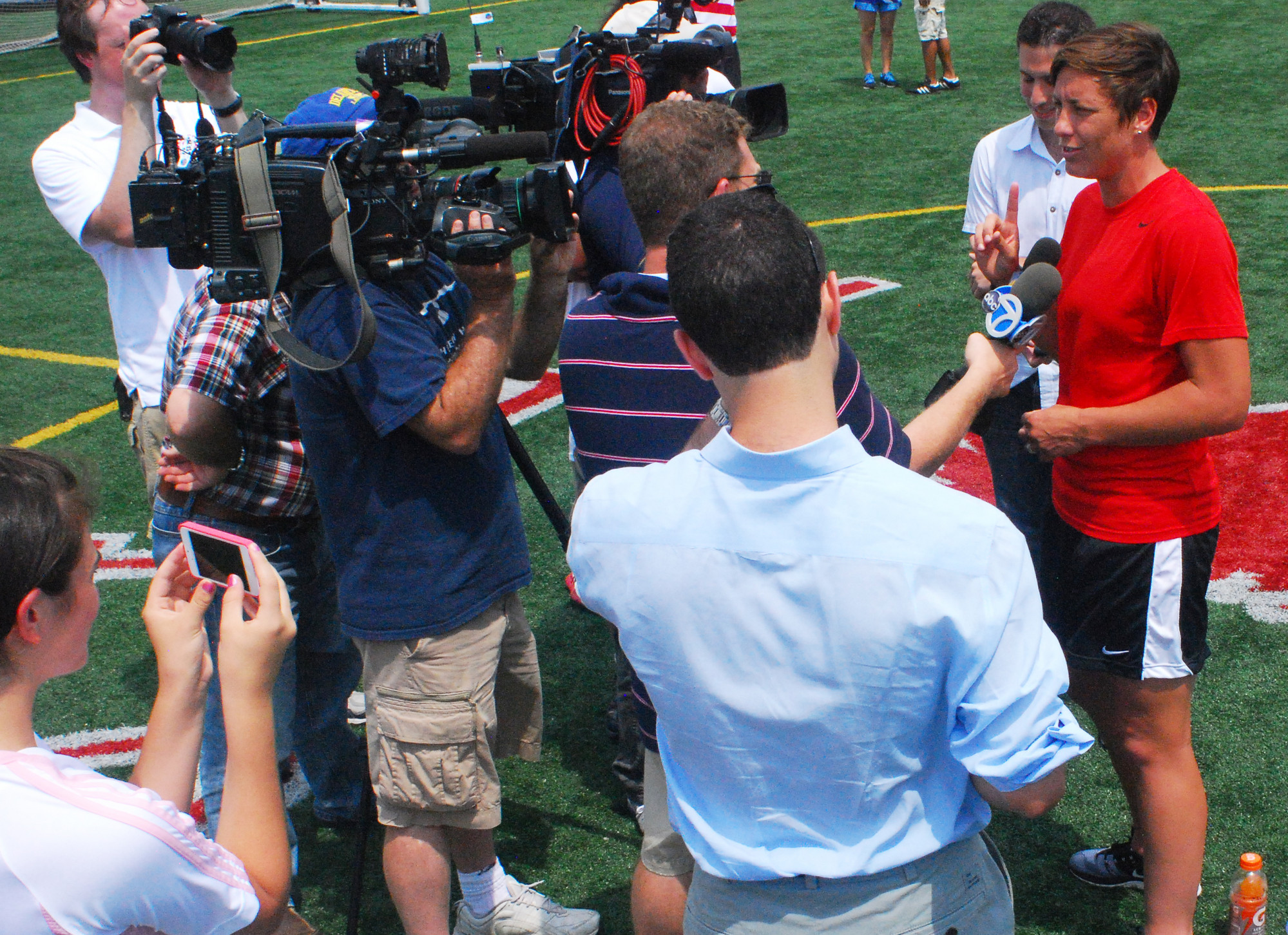 The press converged on Wambach when she wasn�t meeting with campers.